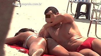 Man sticks his fingers in his girlfriend's ass in the middle of Copacabana beach in Rio de Janeiro