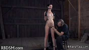 Caged babe forced to give fellatio