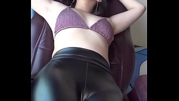 Beautiful booty Asian in shiny latex leggings!