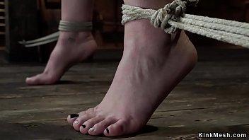Pale brunette suspended in hogtie