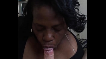 Black woman sucking white clock and taking a load