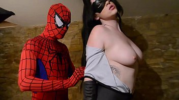 Catwoman takes spiderman´s web on her big tits