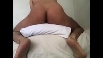 Guy masturbating with pillow