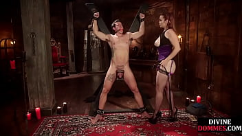 Busty cbt mistress whips and pegs before footjob