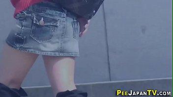 Japanese babes urinate for voyeur