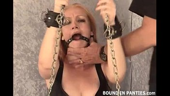 Hot MILF Tori chained and wearing a ball gag