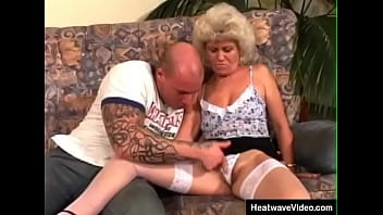 Sexy grandma is still a total fucking whore and spreads her legs in front of young man