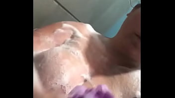 Mature slut caught in the shower as she fondles herself with boobs full of soap
