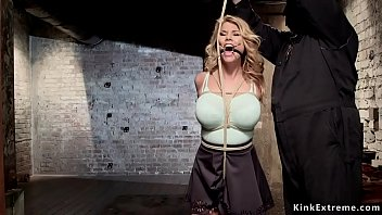 Gagged blonde gets big tits tied