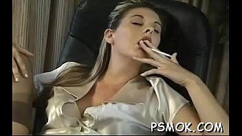 j. girl sitting and enjoying a relaxing smoke