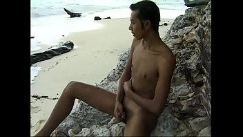 Horny little Asian guy jerckoff on the beach by himself
