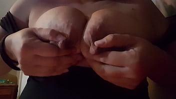 Latina with  big nipples squirting milk