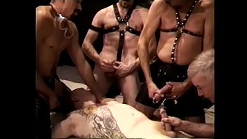 Cock sucking gay dude gets fucked in gang bang and jizzzed