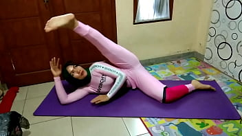 Muslim Woman Doing Yoga Stretching
