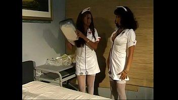 Hot Latina lesbian nurses lick each other sensually at the hospital