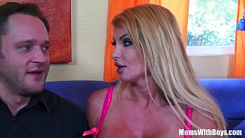 Blonde housewife Taylor Wane with gigantic boobs in sexy lingerie seduces the st