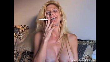 Beautiful blonde MILF enjoys a smoke break 10 min