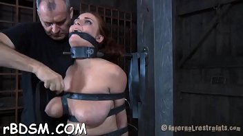 Clamped up angel gets her fuck holes tortured