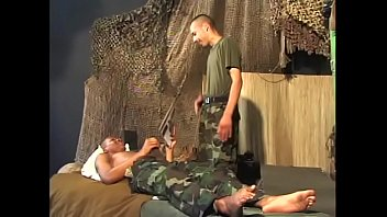 Soldier with belly button jewel fucks man in the ass.