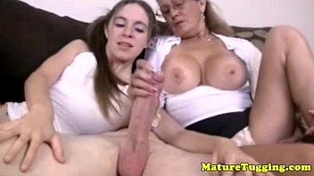 Cougar Mom And Teen Tug Hard Cock Together