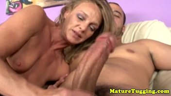 Blonde cougar mom tugging his hard cock