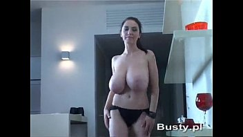 Merilyn Sakova topless while walking around her apartment