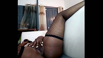 Pleasing pussy in the sofa home alone