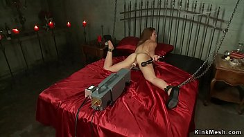 Chained brunette is machine banged