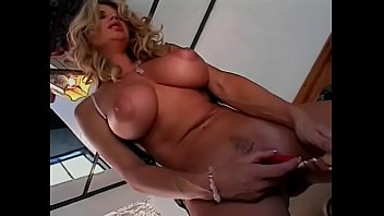 Gorgeous blonde bombshell Vicky Vette likes to caress her feet  and play with her wet twat