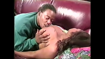 Busty ebony babe in sexy black lingerie lets a black guy eat her wet pussy and rides his big cock