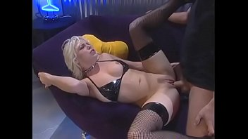 Blonde in leather Missy Monroedeep throats white cock then gets fucked on sofa