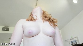 Juicy rehead Lucy Foxx fingers hairy pussy