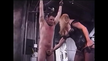 Two mature blondes in leather suits humiliate a tied young guy in the basement