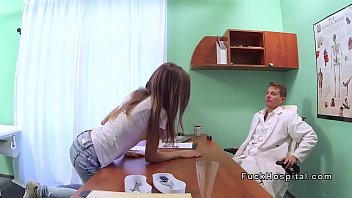 Blonde patient strips on a doctors desk