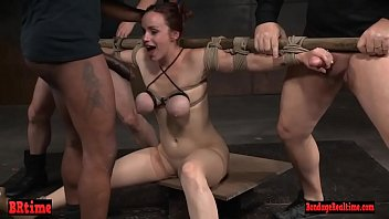 Sassy redhead is bound and breast tied