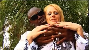 Blonde housewife Sunny Day can't wait when her husband goes to business trip so she will be able to to enjoy every inch of huge dong of her black lover
