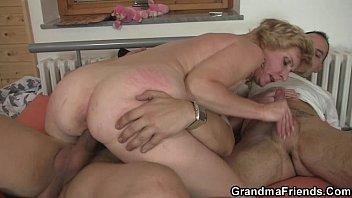 Mature lady enjoys two fresh cocks