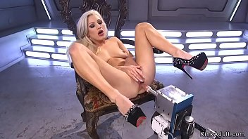 Blonde in fishnets anal fucks machine