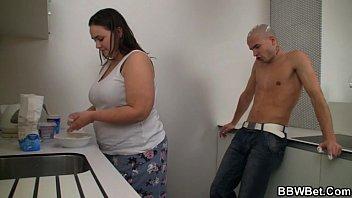 Horny guy bangs cooking BBW