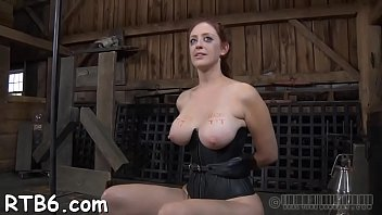 Gagged beauty enjoys anguished torture for her sexy body