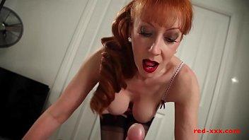 Horny big tit redhead MILF gives her man a wank