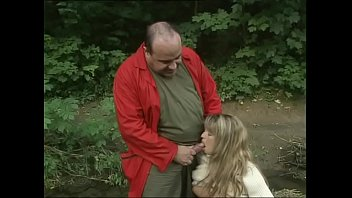 Sweet blondie pissing in the woods gives a blowjob to an ugly mug