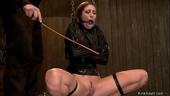 Slave in strait jacket is caned