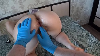 Fisting for my girlfriend with a hairy pussy and a big ass. Home foreplay of a Russian couple. POV.