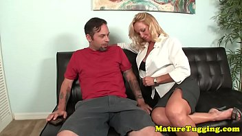Classy MILF jerking cock until it cums