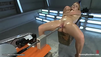 Busty oiled blond machine fucked