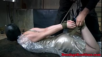 Bent over submissive gets gagged by master