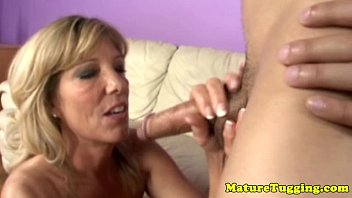 Blonde cougar mom tugs and sucks cock