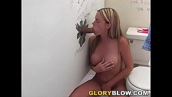 Nikki Lynn Sucks Black Monster Cock Through Gloryhole