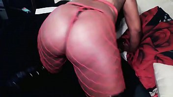 Image: Sexy Wildcat in red fishnet and g-string tease